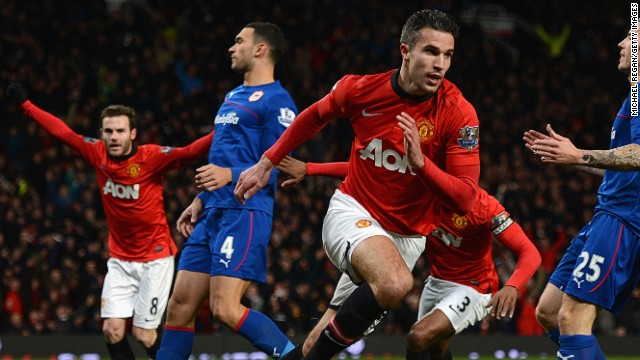 Mata celebrates as Robin van Persie gives Manchester United the lead just six minutes into the Spaniard's debut.
