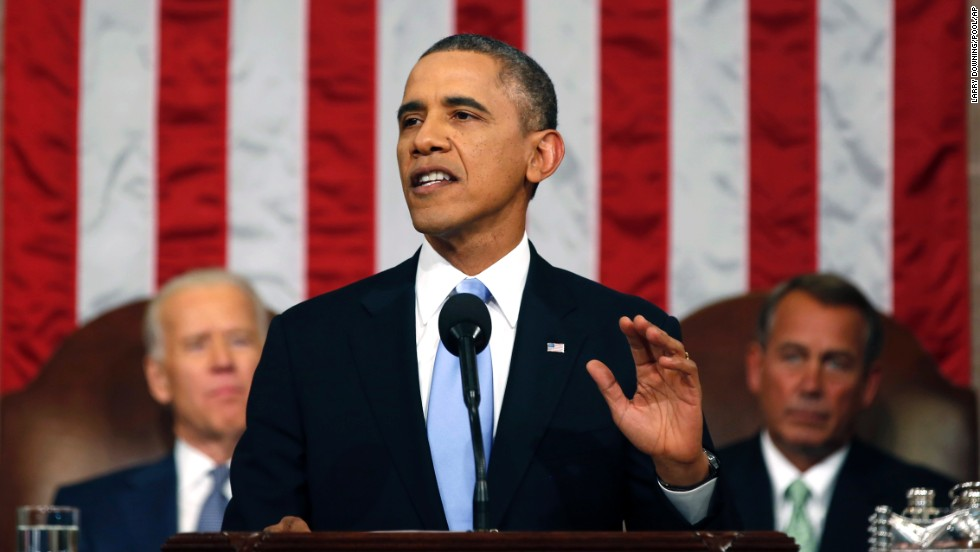 President Barack Obama delivers the State of Union address before a joint session of Congress in the House chamber on Tuesday, January 28, 2014, in Washington, as Vice President Joe Biden, left, and House Speaker John Boehner of Ohio listen.