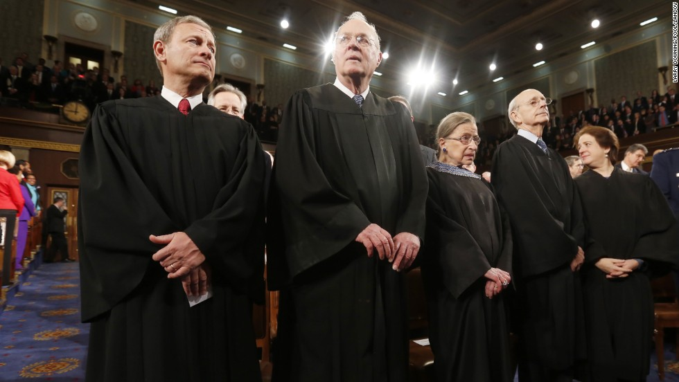 Members of the U.S. Supreme Court (from left): Chief Justice John Roberts, and Justices Anthony Kennedy, Ruth Bader Ginsburg, Stephen Breyer and Elena Kagan prior to the president's speech.