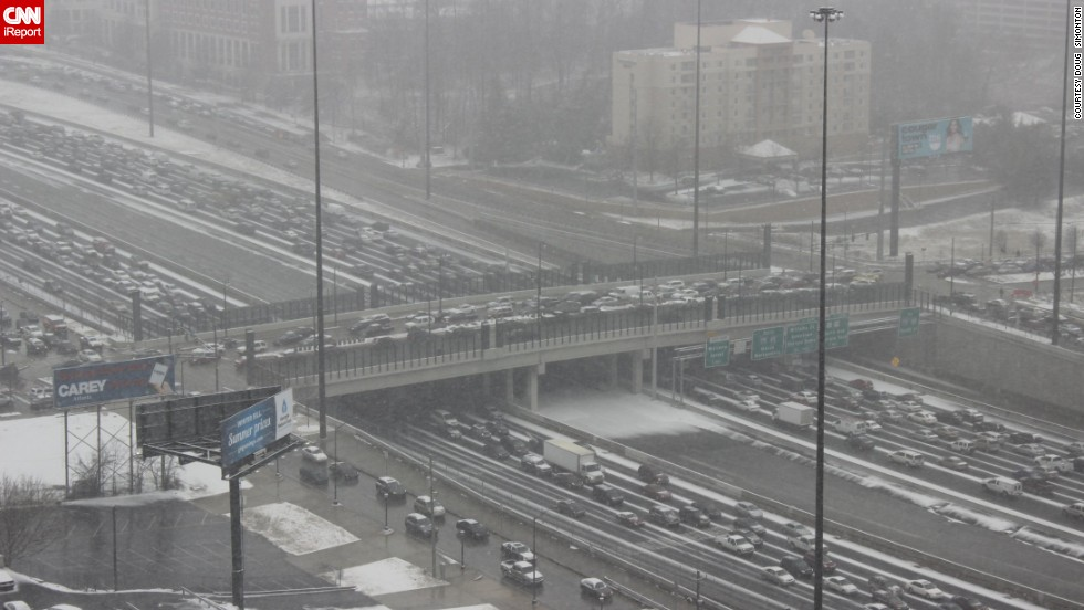 "A rare snowstorm left thousands of motorists trapped on Atlanta interstates overnight. ""Thank God I walk to work everyday,"" said <a href=""http://ireport.cnn.com/docs/DOC-1079053"">Doug Simonton</a>, who snapped this photo Tuesday afternoon."
