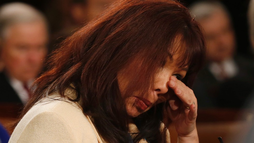 U.S. Rep. Tammy Duckworth wipes away tears during a standing ovation at the State of the Union address for Army Sgt. Cory Remsburg, who was severely wounded while serving in Afghanistan. Duckworth, herself, was also seriously wounded in Iraq while serving as a helicopter pilot.