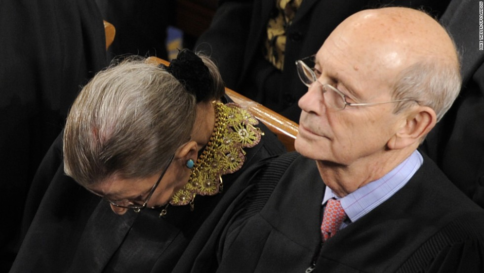 Supreme Court Justice Ruth Bader Ginsburg, head down, and Justice Stephen Breyer were among five members of the Supreme Court to attend the State of the Union address.