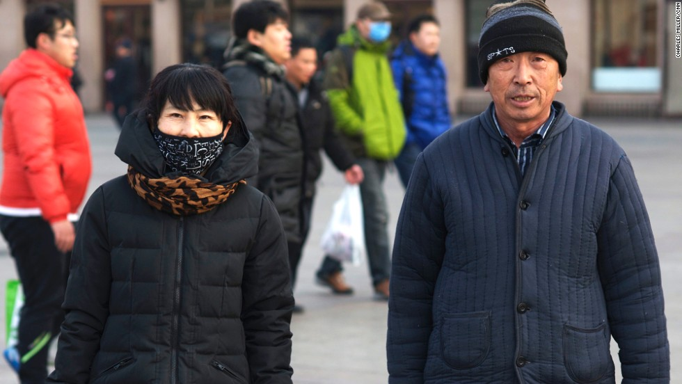 Du Shuxiang (L), 46, came to Beijing from Heilongjiang province three years ago. She works in a pickle factory. She is accompanied by Wang Zhiyou, a sanitation worker who came to Beijing seven years ago from the same town in Heilongjiang province as Du. Wang will wait to go home after New Year's Eve as he couldn't get a ticket to travel in advance.