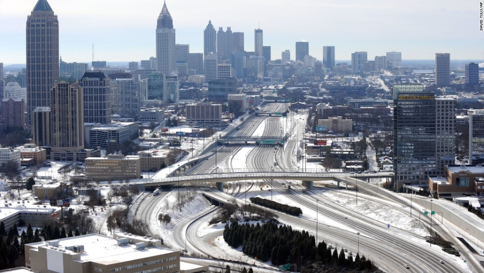 The ice-covered interstate highways running through Atlanta appear empty on January 29.