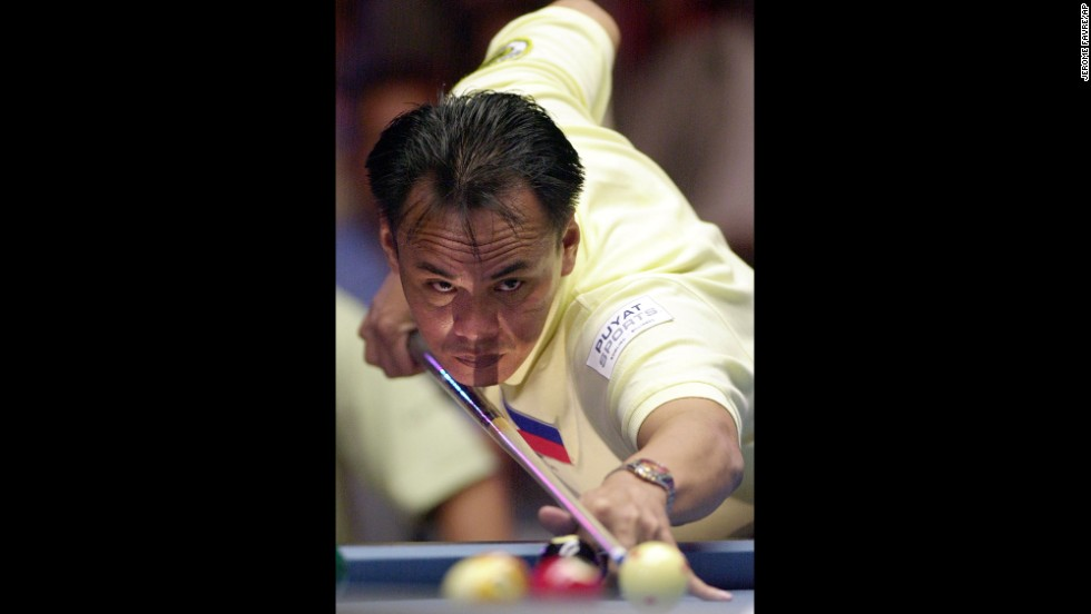 "Pool champs of the 21st century include Francisco ""Django"" Bustamante of the Philippines, seen here lining up a shot at the 2004 World Pool Championship in Taipei. ""I like action,"" <a href=""http://www.billiardsdigest.com/new_current_issue/oct_10/bustamante_2.php"" target=""_blank"">Bustamante told Billiards Digest</a>. ""Gambling in pool makes you strong. It builds your heart, your nerves, and you get the experience. ... There are a lot of good players in the Philippines. And everybody's hungry."""