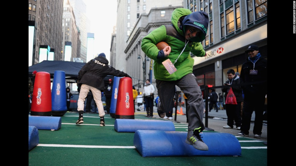 A boy completes a Super Bowl obstacle course in New York City on Wednesday, January 29. Times Square has been transformed into Super Bowl Boulevard ahead of the big game.