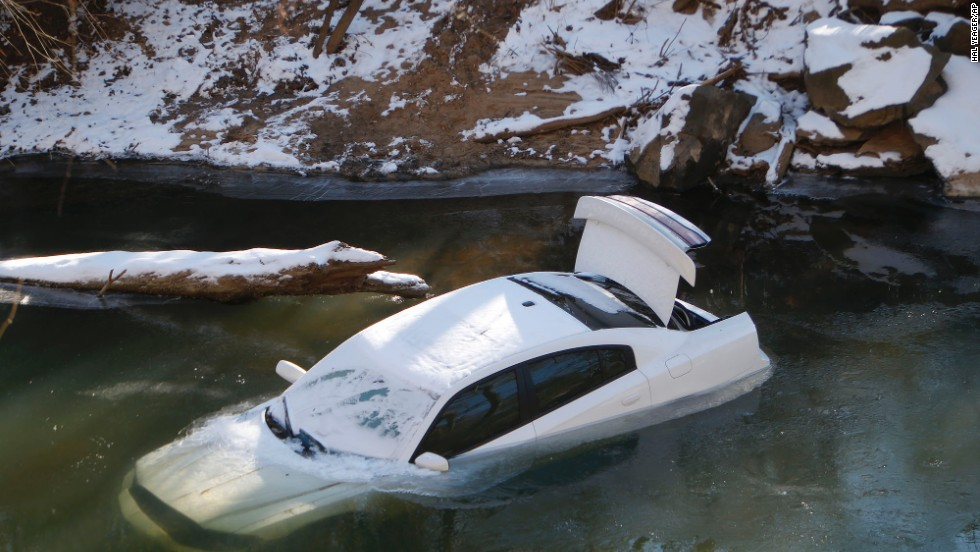 A car lies half submerged in the Cahaba River in Mountain Brook, Alabama, on Thursday, January 30. The driver was able to escape before the car slid into the river during a snow storm on Tuesday and was not injured. A wave of arctic air that started over the Midwest and Plains spread to the Southeast, bringing snow, freezing ice and sleet to a region that doesn't deal with such weather very often.