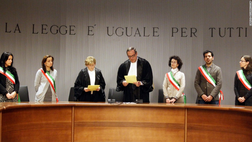 Appeals Court Judge Alessandro Nencini, center, reads the verdict in the death of British student Meredith Kercher in Florence, Italy, on Thursday, January 30, 2014. The appeals court upheld the convictions of  Knox and her ex-boyfriend Raffaele Sollecito for the 2007 murder of her British roommate. Knox was sentenced to 28½ years in prison, raising the specter of a long legal battle over her extradition. Sollecito's sentence was 25 years.