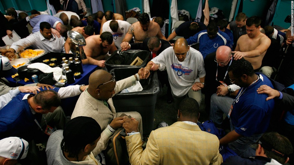 "Tony Dungy, former coach of the of the Indianapolis Colts, gathers his team in prayer in the locker room after winning Super Bowl XLI against the Chicago Bears in 2007. ""We all want to be good citizens and do the right thing. But without faith at the core -- faith and understanding that you are put on this Earth by God for a reason -- it can be pretty hollow,"" Dungy told Christianity Today in 2009."
