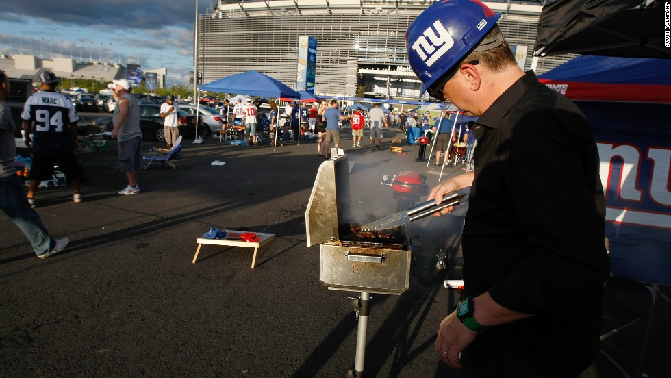 With open flames, charcoal grills, propane or gas tanks disallowed for tailgaters on Super Bowl Sunday, MetLife Stadium executive chef Eric Borgia has his work cut out for him. It takes a staff of 200 cooks to prepare food for the 80,000 hungry fans, and menus went into the planning stages over a year ago. To represent the flavors of the New York / New Jersey region, he's offering foods such as hot corned beef and pastrami hoagies and a chicken-sausage and Tuscan kale sandwich (Manhattan), pork and chicken steamed buns with pickled slaw and spicy sriracha aioli (Queens), and his own Nana Fusco's rice balls (Brooklyn).