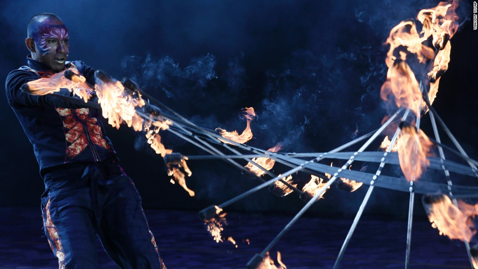 A performer slings fire during a parade in Hong Kong.