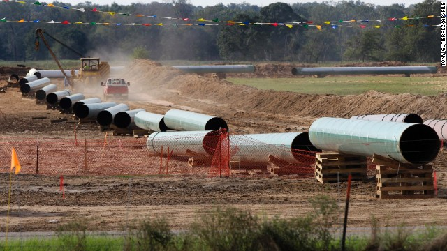 File - In the is Oct. 4, 2012 file photo, large sections of pipe are shown on a neighboring property to Julia Trigg Crawford family farm, in Sumner Texas. On Wednesday, Jan 22, 2014, TransCanada said in a statement on its website that it is delivering oil through the Gulf Coast portion of its proposed Keystone XL pipeline, from a hub in Cushing, Okla., to Houston-area refineries. (AP Photo/Tony Gutierrez, file)