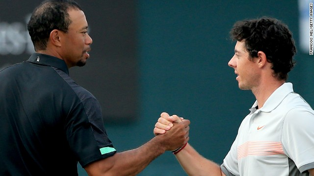 Rory McIlroy shakes hands with Tiger Woods after his second round 70 left him a shot clear of the field at the Dubai Desert Classic.