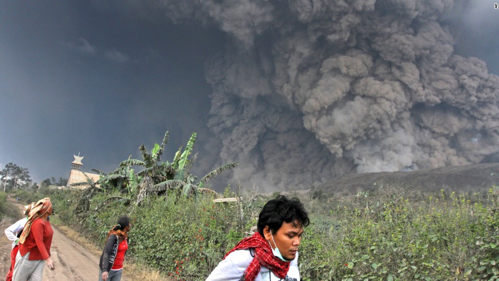 Villagers flee as Mount Sinabung erupts on February 1, in North Sumatra, Indonesia.