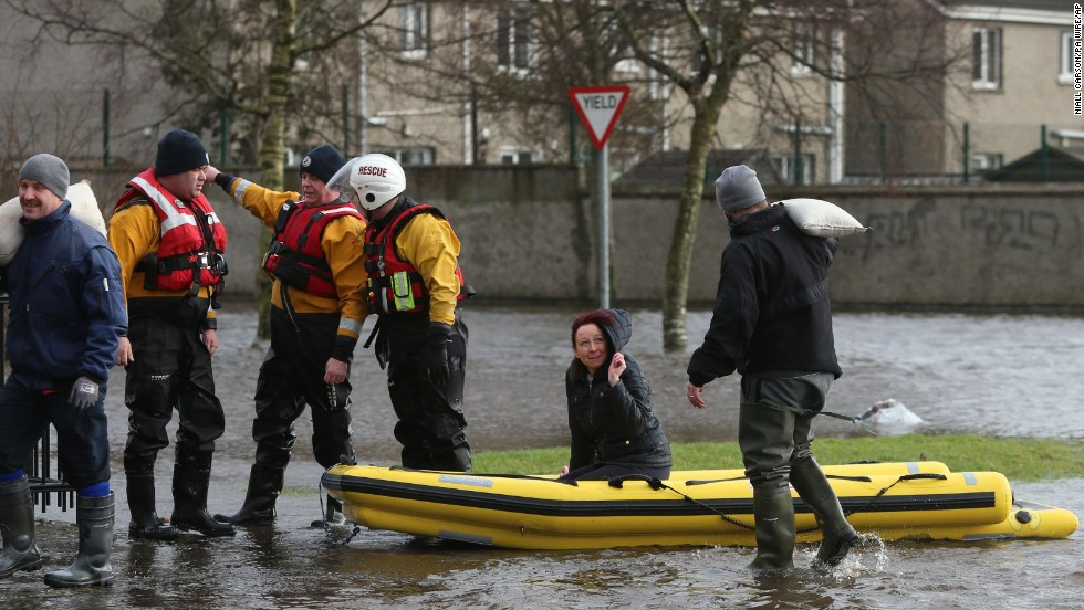 Residents use a boat to navigate flood waters after a flash flood on Saturday, February 1, in Limerick City, Ireland.