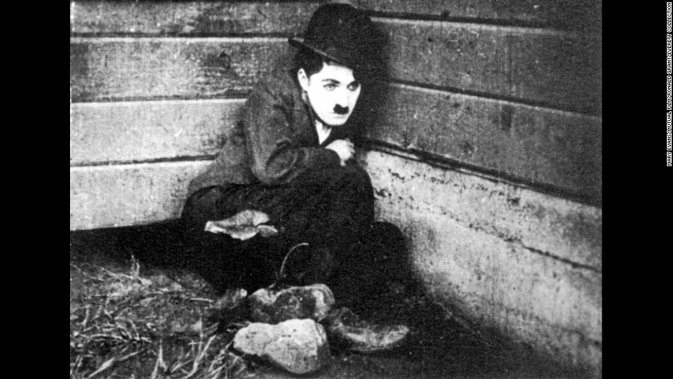 """1917's """"Easy Street"""" sees Chaplin's Tramp go on the straight and narrow to win the love of his sweetheart. The Tramp becomes a policeman and works to reform a rough part of town."""