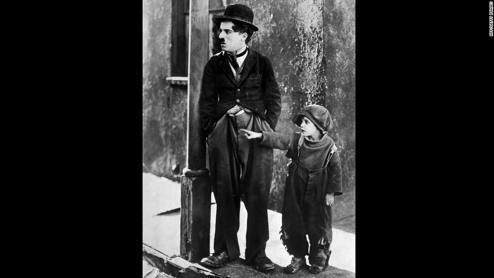 "The Tramp comes to the rescue of an abandoned child, played by Jackie Coogan, in ""The Kid"" (1921)."