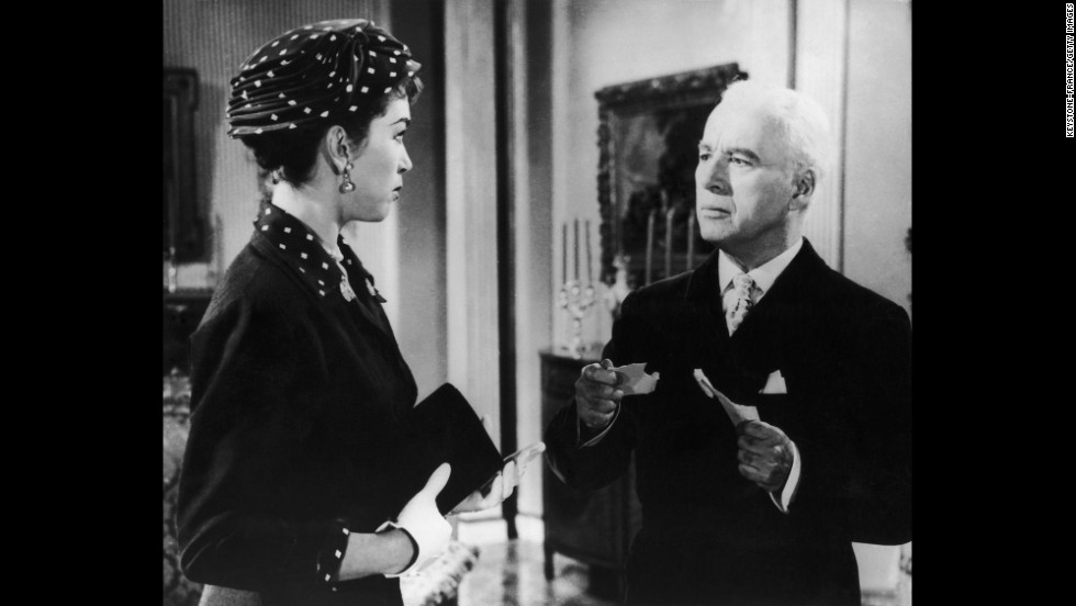 "In ""A King in New York"" (1957), Chaplin, seen here in a scene with actress Dawn Addams, plays a king fleeing a revolution who turns to making TV commercials for a living. Later the king is accused of being a communist."
