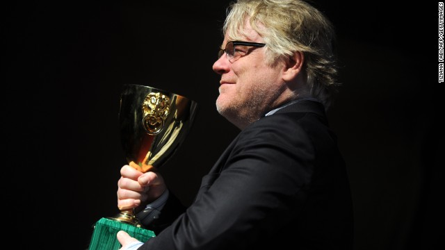 "US actor Philip Seymour Hoffman poses with the Coppa Volpi for the Best Actor he received with US actor Joaquin Phoenix for ""The Master"" during a photocall after the award ceremony of the 69th Venice Film Festival on September 8, 2012 at Venice Lido.    AFP PHOTO / TIZIANA FABI        (Photo credit should read TIZIANA FABI/AFP/GettyImages)"