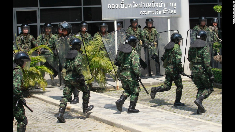 Thai soldiers move in as anti-government protesters stage a rally in Bangkok on February 3.