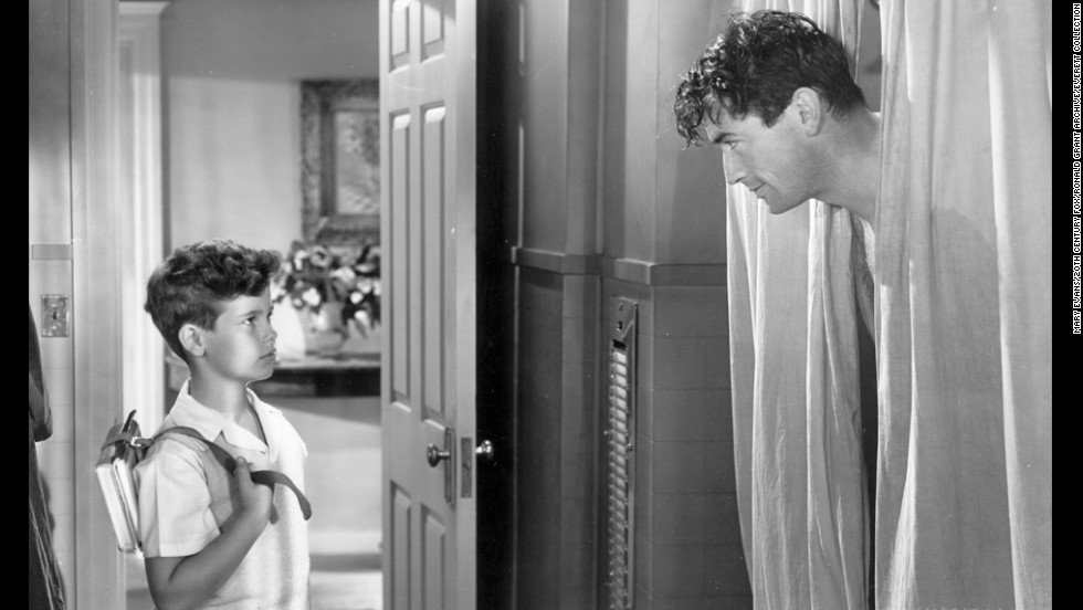 """Elia Kazan's """"Gentleman's Agreement"""" continued Hollywood's exploration of more serious subject matter, this time anti-Semitism. Gregory Peck, right, plays a reporter who goes undercover posing as a Jew, making his girlfriend (Dorothy McGuire) face uncomfortable truths about her upper class WASP life. A young Dean Stockwell played Peck's son."""