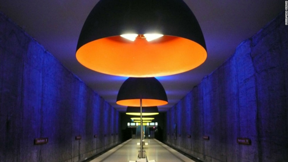 Enormous dome lights, bathing the platforms in haunting blue, red and yellow shades, make this otherwise ordinary little station roar.