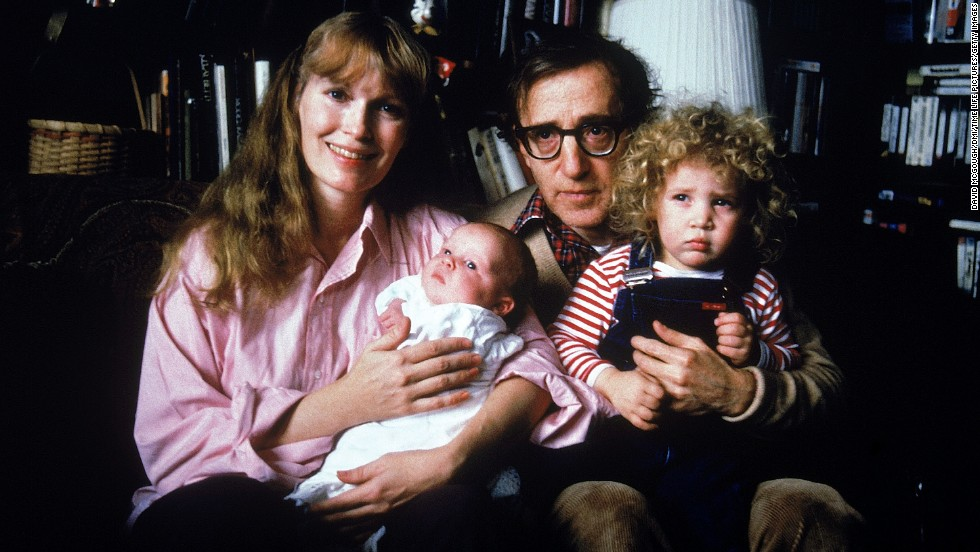 Actress Mia Farrow had a long-term relationship with actor/director Woody Allen, whom she met in 1979. She starred in 13 of his films and he was believed to be the father of her son Satchel (shown here as an infant) as well as the acting father of her other children, including adopted daughter Dylan shown here being held by Allen. The couple split in 1992.