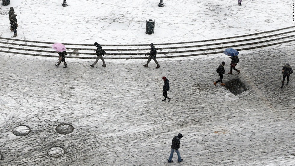 Pedestrians trudge through dirty snow and slush as they pass through New York's Union Square on February 3.