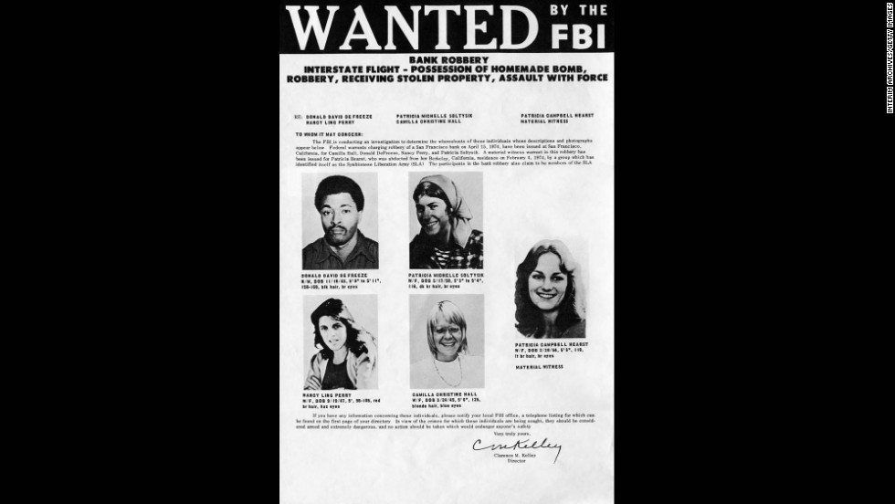Four days after the robbery, the FBI released this wanted poster, featuring Hearst, far right, as a material witness, and SLA members suspected of taking part in the heist. Leader Donald DeFreeze is at top left.