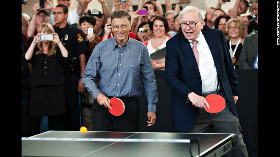 Gates, left, and Warren Buffett, chairman of Berkshire Hathaway, play table tennis during an event at the Berkshire Hathaway shareholders meeting in Omaha, Nebraska, on May 6, 2012.