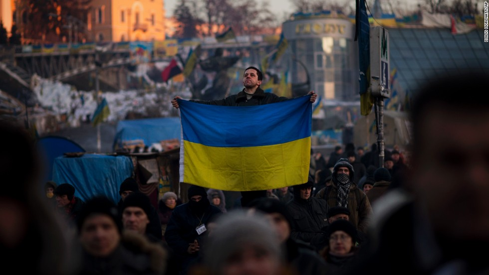 A protester holds a Ukrainian flag in Independence Square on Tuesday, February 4.