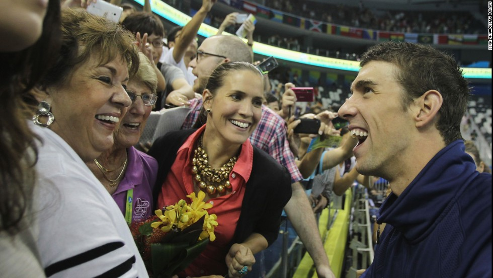 American swimmer Michael Phelps shares a joke with his mother, Debbie, left, and his sister Hilary after a race at the World Championships in Shanghai, China, in 2011.