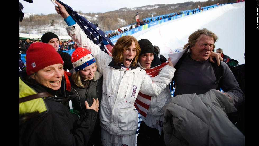 U.S. snowboarder Shaun White is surrounded by his family after winning gold during the 2006 Olympic Games in Italy. From left is his mother, Cathy; his sister, Kari; his brother, Jesse; and his father, Roger.