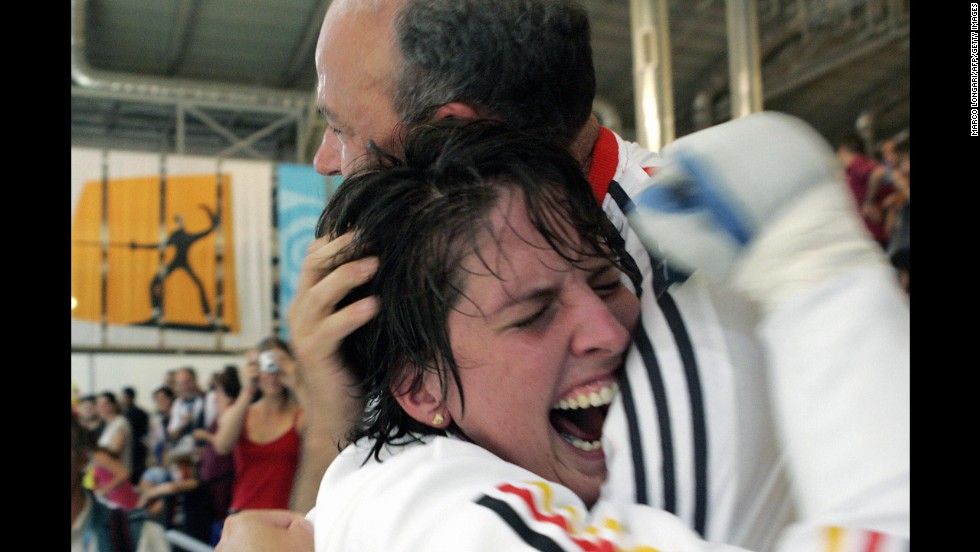 German fencer Imke Duplitzer hugs her father after an Olympic win in 2004.