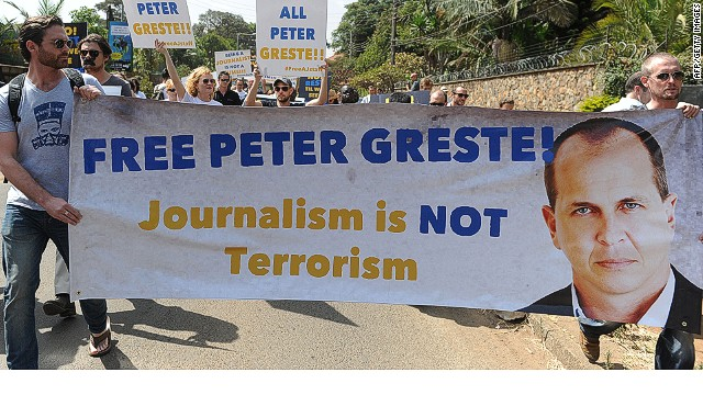 Foreign journalists hold banners bearing a picture of Peter Greste, an Australian journalist who was arrested and detained in Cairo while on assignment for Qatar-based Al-Jazeera network, on December 29, 2013, as they march to the Egyptian Embassy in Nairobi, on February 4, 2014. Greste and two others journalists are accused of spreading lies harmful to state security and joining a terrorist organisation.AFP PHOTO/SIMON MAINASIMON MAINA/AFP/Getty Images