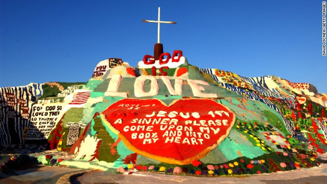 406024 01: (FEATURE STORY- SALVATION MOUNTAIN- 1 OF 23) Salvation Mountain expresses 'God is love' and other Biblical messages May 30, 2002 near Niland, CA, east of the Salton Sea. 70-year-old Leonard Knight has been painting and repainting his spiritual hill for 17 years, using an estimated 100,000 gallons of donated paint. The state once tried to declare it a hazardous waste site and have it destroyed but Knight prevailed and it now attracts the attention of journalists and folk art lovers worldwide. The Folk Art Society of America has declared 100 foot-wide, three-story tall painted hill a national folk art shrine and a leading folk arts scholar is petitioning Congress to recognize Salvation Mountain as a national treasure for permanent protection. (Photo by David McNew/Getty Images)