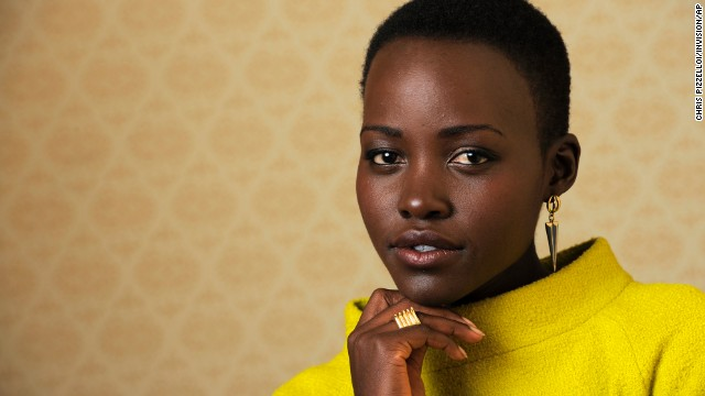 "Lupita Nyong'o, a cast member in ""12 Years a Slave,"" poses for a portrait on day 3 of the 2013 Toronto International Film Festival on Saturday, Sept. 7, 2013 in Toronto. (Photo by Chris Pizzelloi/Invision/AP)"