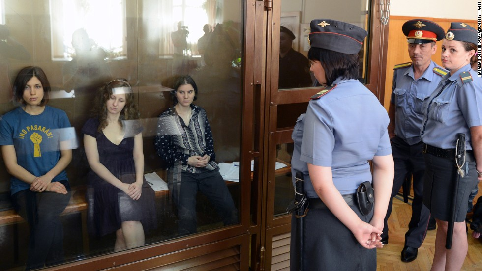 From left, Tolokonnikova, Alyokhina and Yekaterina Samutsevich sit inside a glass enclosure during a court hearing in Moscow in August 2012. Samutsevich, also a member of Pussy Riot, was eventually given a suspended sentence and freed by an appeals court.