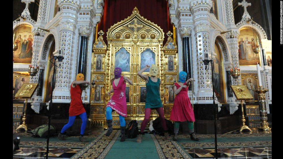 "Pussy Riot members perform their ""punk prayer"" protest inside Moscow's Cathedral of Christ the Savior on February 21, 2012. The girls were marched out of the cathedral by guards."