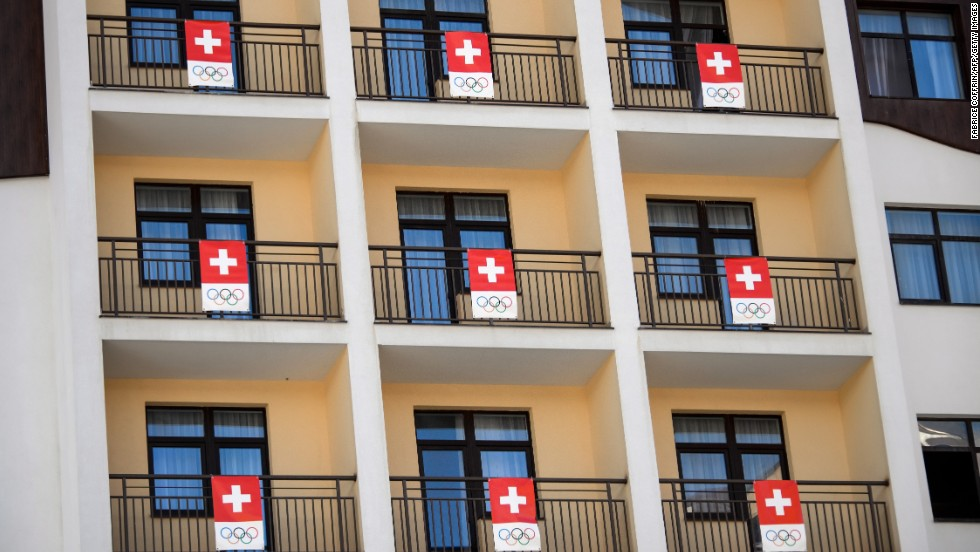 Anybody is anybody sports a flag in the Olympic Village. Hats off to the Swiss for their effortless flag co-ordination.