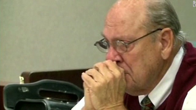 Ex-cop charged in killing weeps in court