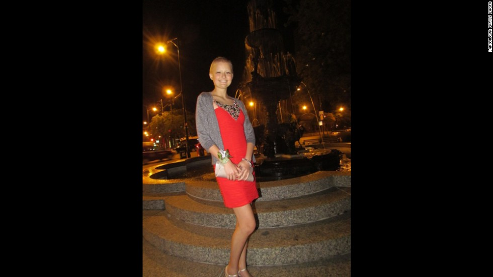 Daniela wears a bright red dress for her homecoming dance in September 2012.