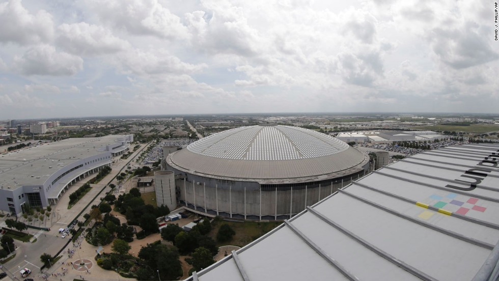 The view of the Houston Astrodome as seen from Reliant Stadium, which opened in 2002 and will host the Super Bowl in 2017.