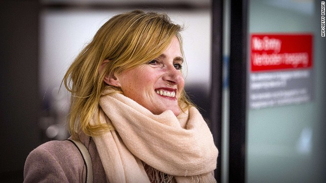 "Dutch journalist Rena Netjes smiles on February 4, 2014 as she arrives at Schiphol Airport, the Netherlands, after being accused by Egypt of being part of a ""terror cell"" involving Qatari-owned broadcaster Al-Jazeera. Netjes flew out of Cairo early February 4 after several days in hiding, following a crackdown on the pan-Arab satellite broadcaster which Cairo accuses of backing the Muslim Brotherhood ousted from power by the military in July. AFP PHOTO / ANP / REMKO DE WAAL -- The Netherlands out -- REMKO DE WAAL/AFP/Getty Images"