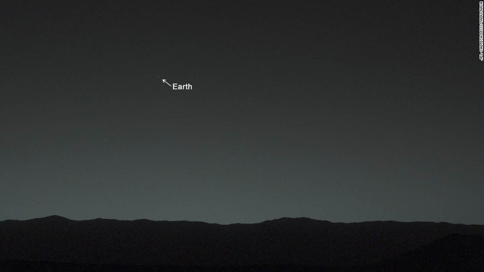 "This view of the twilight sky and Martian horizon, taken by Curiosity, includes Earth as the brightest point of light in the night sky. Earth is a little left of center in the image, and our moon is just below Earth. A human observer with normal vision, if standing on Mars, could easily see Earth and the moon as two distinct, bright ""evening stars."""