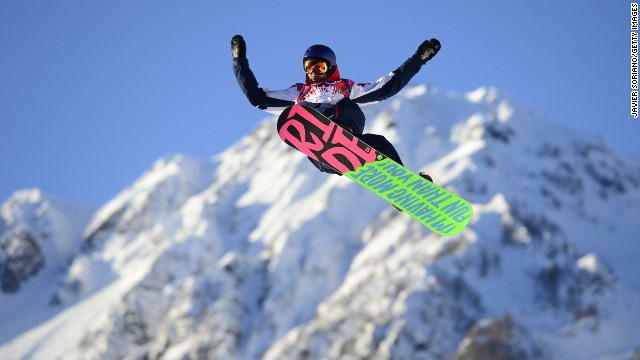 British snowboarder Billy Morgan flies high as the first athlete to compete in the 2014 Winter Olympics.