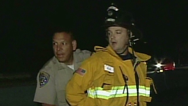 newday pkg elam firefighter handcuffed by police_00000913.jpg