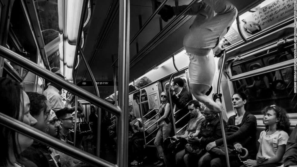 "<strong>Shortlist: My New York</strong><br />Photo and caption by Mikolaj Nowacki<br />""Young man dances on a train to earn money, New York. During my first, short stay in New York in June 2013 I was seduced by this city. I love the incredible energy which is almost tangible there. I love the diversity of people of so many cultures, skin tones and religions living together. For a week, in my free time I used to roam the streets being fascinated by everything which was going on around me. I used to walk for so many hours that I only stopped when I burnt out my energy."""