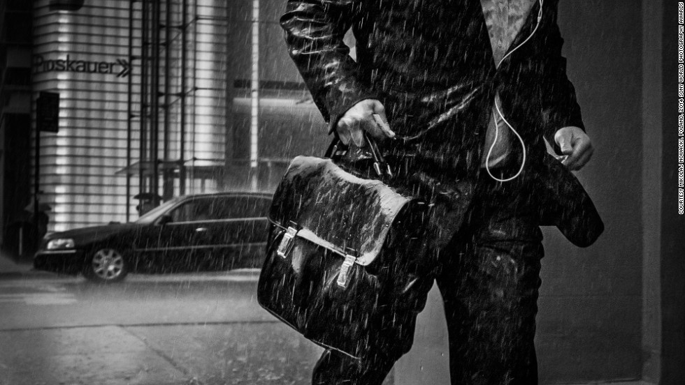 "<strong>Shortlist: My New York</strong><br />Photo and caption by Mikolaj Nowacki<br />""Man runs away from rain, along the 8th Avenue under The New York Times Building, Manhattan, New York. During my first, short stay in New York in June 2013 I was seduced by this city. I love the incredible energy which is almost tangible there. I love the diversity of people of so many cultures, skin tones and religions living together. For a week, in my free time I used to roam the streets being fascinated by everything which was going on around me. I used to walk for so many hours that I only stopped when I burnt out my energy."""