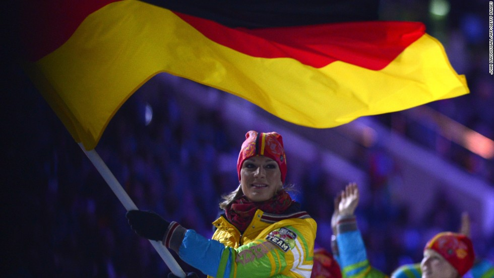 Germany's flag bearer, skier Maria Hoefl-Riesch, leads the German delegation.